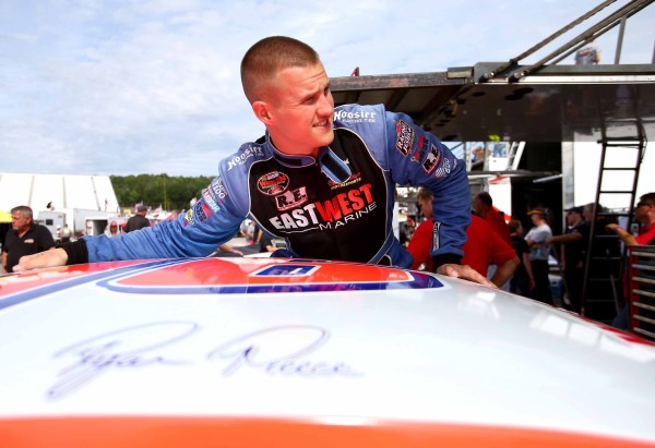 Ryan Preece getting out of his #16 Whelen Modified at New Hampshire Motor Speedway on July 13, 2013 [Getty Images/NASCAR Media]